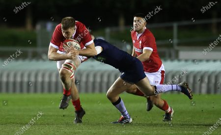 Ben Carter of Wales is tackled by Rory Darge of Scotland.