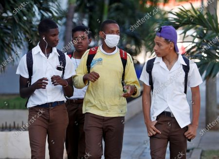 Stock Photo of Cubans prepare for the coronavirus with face masks in Havana, Cuba, 13 March 2020. The first Cuban citizen with a positive diagnosis of coronavirus was disclosed this Thursday by the Cuban Ministry of Public Health (Minsap), after the cases of three Italian tourists reported twenty-four hours ago. This is a resident of the central city of Santa Clara, married to a Bolivian citizen living in Milan, Lombardy region, Italy, who traveled to the island on February 24, apparently asymptomatic, but later began to develop mild respiratory symptoms, as detailed in the report.