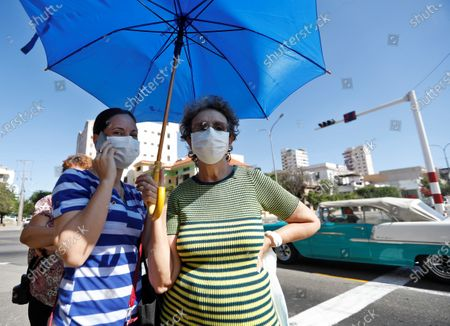 Cubans prepare for the coronavirus with face masks in Havana, Cuba, 13 March 2020. The first Cuban citizen with a positive diagnosis of coronavirus was disclosed this Thursday by the Cuban Ministry of Public Health (Minsap), after the cases of three Italian tourists reported twenty-four hours ago. This is a resident of the central city of Santa Clara, married to a Bolivian citizen living in Milan, Lombardy region, Italy, who traveled to the island on February 24, apparently asymptomatic, but later began to develop mild respiratory symptoms, as detailed in the report.