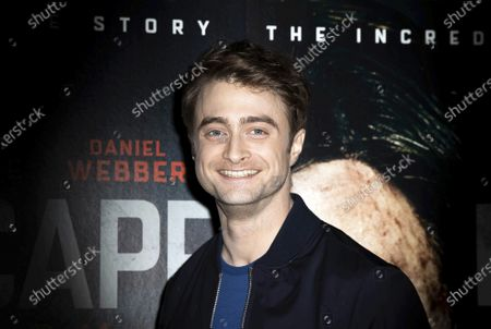 """Stock Image of Actor Daniel Radcliffe poses for photographers upon arrival at a screening of the film """"Escape From Pretoria"""" in London. On Friday, March 13, 2020, The Associated Press reported on stories circulating online incorrectly asserting that actor Daniel Radcliffe tested positive for coronavirus. A Twitter account made to closely resemble that used by BBC Breaking News with the handle @BBCNewsTonight spread the claim, which was later retweeted by social media users, including celebrities on their verified accounts. Scott Boute, who represents Radcliffe, told The Associated Press in an email that the claim was not true"""