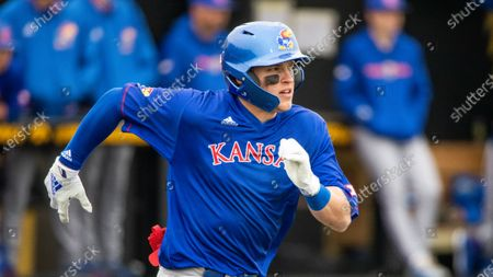 Kansas' Jack Wagner runs to first base during an NCAA baseball game against Iowa, in Iowa City, Iowa