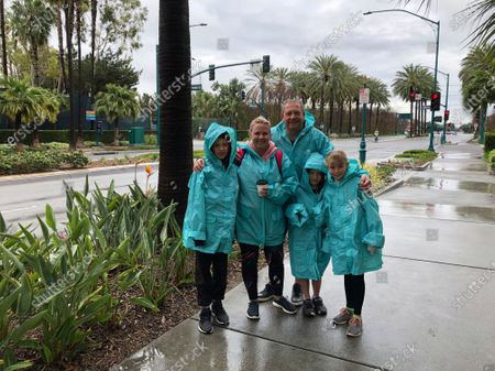 Rochelle Van Eysden, 46, and Jeremy Grice, 45, with children Max, 11; Ava, 9; and Leo, 6 stand outside Disneyland in Anaheim, Calif. on . They traveled from New Zealand to Disneyland and planned to stay three days but their trip to the resort was cut short to two by the closure. They're supposed to head on a seven-day cruise this weekend down to Mexico and that trip is also on shaky footing, she said. Disneyland is closing its doors for the rest of the month, shuttering one of California's best-known attractions as the state hurries to stop the spread of the coronavirus