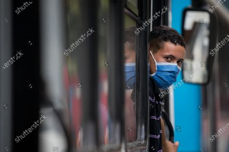 A man wears a mask in Caracas, Venezuela, 13 March 2020. The Vice President of the Government of Venezuela, Delcy Rodriguez, confirmed on 13 March the first two cases of coronavirus in the country and called for preventive quarantine for travelers who arrived from Spain last week.