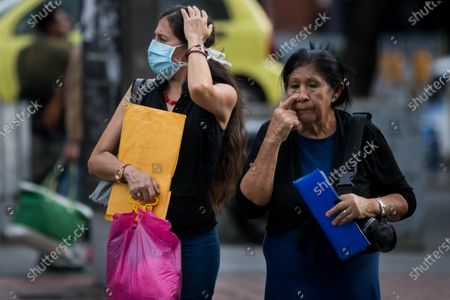 A woman wears a mask in Caracas, Venezuela, 13 March 2020. The Vice President of the Government of Venezuela, Delcy Rodriguez, confirmed on 13 March the first two cases of coronavirus in the country and called for preventive quarantine for travelers who arrived from Spain last week.