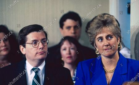 New White House Communications Director Mark Gearan (L) standing next to Press Secretary Dee Dee Myers (R) waiting to be introduced by presidential adviser David Gergen in the White House briefing room.