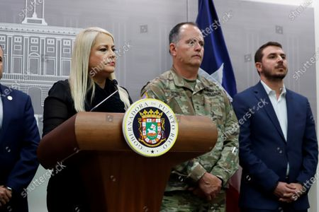 Governor of Puerto Rico Wanda Vazquez Garced (L), National Guard's assistant general Jose Reyes (C) and Director of the Port Authority Joel Piza (R) attend a press conference in San Juan, Puerto Rico, 13 March 2020. Vazquez Garced announced that all public schools will remain closed until 30 March after three cases of coronavirus were detected in the country.