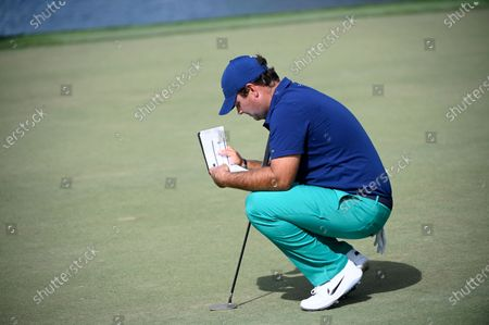 Patrick Reed waits to a putt on the eighth green during the first round of the Arnold Palmer Invitational golf tournament, in Orlando, Fla
