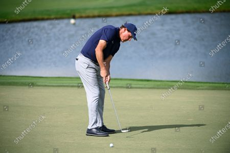 Phil Mickelson watches his putt on the eighth green during the first round of the Arnold Palmer Invitational golf tournament, in Orlando, Fla