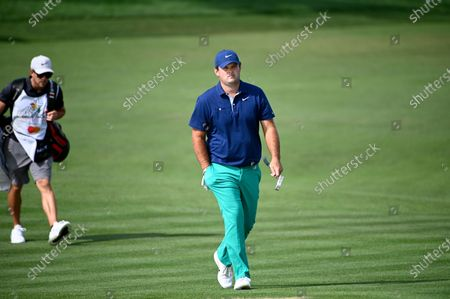 Patrick Reed, right, walks to the eighth green during the first round of the Arnold Palmer Invitational golf tournament, in Orlando, Fla