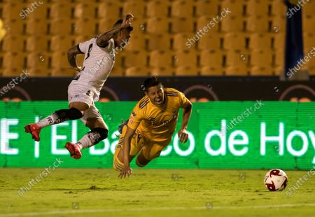 Hugo Ayala (R) of Tigres UANL in action against Dario Lezcano (L) of Bravos de Juarez FC during a Clausura 2020 Tournament soccer match at University stadium in Monterrey, Mexico, 14 March 2020. The game was played behind closed doors amid the coronavirus pandemic crisis.