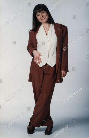 Charlotte Attenborough Actress Wearing A Brown Trouser Suit And Cream Blouse...