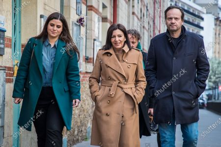 The incumbent mayor of Paris, Anne Hidalgo (C) arrives with her husband Jean-Marc Germain (R) at the polling station of the 15th district, during the first round of the French Municipal elections in Paris, France, 15 March 2020. France is holding nationwide elections to choose all of its mayors and other local leaders despite a crackdown on public gatherings because of the new Covid-19 coronavirus. Several European countries have closed borders, schools as well as public facilities, and have cancelled most major sports and entertainment events in order to prevent the spread of the SARS-CoV-2 coronavirus causing the Covid-19 disease.