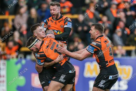 Castleford's Jake Truman celebrates his try with George Griffin, Danny Richardson and Michael Shenton.