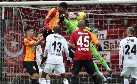 Galatasaray's Ryan Donk (C-L, top) in action against Besiktas' goalkeeper Loris Karius (C-R, top) during the Turkish Super League soccer derby match between Galatasaray and Besiktas in Istanbul, Turkey, 15 March 2020. Turkish Super League soccer matches are played without spectators over the COVID-19 coronavirus threat.