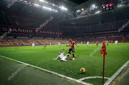 Galatasaray's Florin Andone (R) in action against Besiktas' Domagoj Vida (L) during the Turkish Super League soccer derby match between Galatasaray and Besiktas in Istanbul, Turkey, 15 March 2020. Turkish Super League soccer matches are played without spectators over the COVID-19 coronavirus threat.