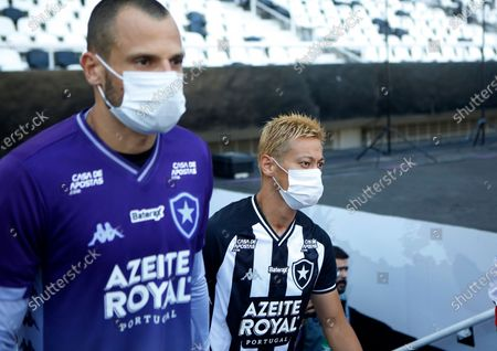 Botafogo's Keisuke Honda, of Japan, wears a mask prior to a Carioca Championship soccer match against Bangu in Rio de Janeiro, Brazil, . The match was played in an empty, closed door stadium, as part of the measures to contain transmission of the new coronavirus. The vast majority of people recover from the new virus
