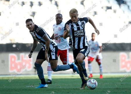 Botafogo's Keisuke Honda, of Japan, right, controls the ball during a Carioca Championship soccer match against Bangu at Nilton Santos stadium in Rio de Janeiro, Brazil, . The match is played in an empty, closed door stadium to contain transmission of the new coronavirus