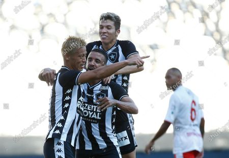 Botafogo's Keisuke Honda, of Japan, celebrates after scoring his side's opening goal from the penalty spot during a Carioca Championship soccer match against Bangu in Rio de Janeiro, Brazil, . The match was played in an empty, closed door stadium to contain transmission of the new coronavirus