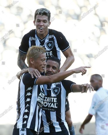 Botafogo's Keisuke Honda, of Japan, celebrates with teammates after scoring from the penalty spot his side's opening goal against Bangu during a Carioca Championship soccer match in Rio de Janeiro, Brazil, . The match was played in an empty, closed door stadium to contain transmission of the new coronavirus