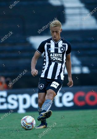 Botafogo's Keisuke Honda, of Japan, controls the ball during a Carioca Championship soccer match against Bangu in Rio de Janeiro, Brazil, . The match was played in an empty, closed door stadium to contain transmission of the new coronavirus