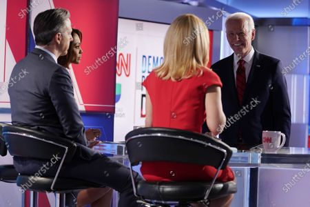 Stock Image of Former Vice President Joe Biden, far right, stops to talk with news anchors from l-r., Ilia Calderón, Jake Tapper, and Dana Bash, following the conclusion of the Democratic presidential primary debate at CNN Studios, in Washington