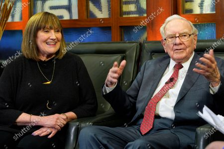 """Stock Image of In this May 7, 2018 photo, Susie Buffett, along with her father, Berkshire Hathaway Chairman and CEO Warren Buffett, right, are seen during an interview in Omaha, Neb., on Fox Business Network's """"Countdown to the Closing Bell"""". Omaha Mayor Jean Stothert told reporters during a news conference, that Susie Buffett has been exposed to COVID-19 and is in self isolation"""