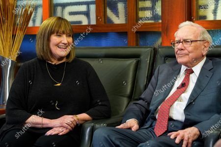 """Stock Photo of In this May 7, 2018 photo, Susie Buffett, along with her father, Berkshire Hathaway Chairman and CEO Warren Buffett, right, are seen during an interview in Omaha, Neb., on Fox Business Network's """"Countdown to the Closing Bell"""". Omaha Mayor Jean Stothert told reporters during a news conference, that Susie Buffett has been exposed to COVID-19 and is in self isolation"""