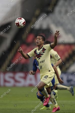 America's Giovani Dos Santos, goes for the ball during a Mexican soccer league match against Cruz Azul at Azteca stadium in Mexico City, . The match was played behind closed doors as a precaution against the spread of the new coronavirus