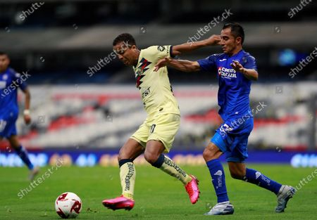 Giovani Dos Santos (L) of Club America in action against Rafael Baca (R) of Cruz Azul during the Clausura Tournament soccer match between Club America and Cruz Azul at the Azteca Stadium in Mexico City, Mexico, 15 March 2020. This match was played behind closed doors due to the coronavirus and COVID-19 pandemic.
