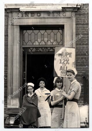 Stock Photo of Strikes National Health Service 1982 Nupe Strike And Picket At St Mary's Hospital Nurses On Picket Duty At Various Entrances Of The Hospital Including 'the Lindo Wing' Where Princess Of Wales Left Yesterday. Pupil Nurses Heather Bright (left) & Louise Butterfield (right) Holding Placard. Pictured In The Foreground With Other Nurses Behind Including Ward Sister Gill Black.
