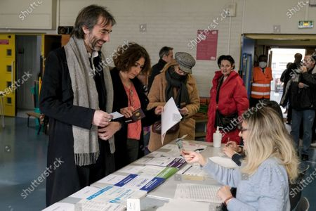 Cedric Villani, the candidate for mayor of Paris on the Nouveau Paris list, votes for the first round of municipal elections in a polling station in the 14th arrondissement of the capital