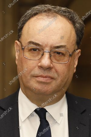 The new Bank of England Governor Andrew Bailey poses for a photograph on the first day of his new role at the central bank in London, . Andrew Bailey is replacing Mark Carney