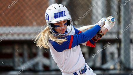 UMass Lowell's Christina Rizzi connects for a hit during an NCAA softball game against Purdue Fort Wayne, in Clarksville, Tenn