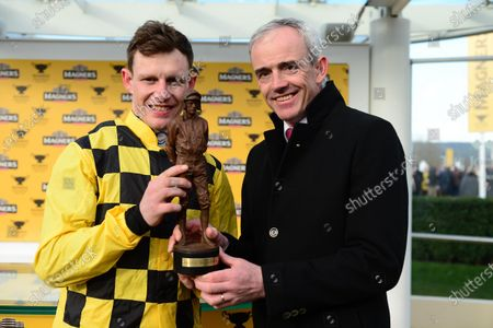 Cheltenham. PAUL TOWNEND accepts his Leading Jockey Award for The Festival from Ruby Walsh.
