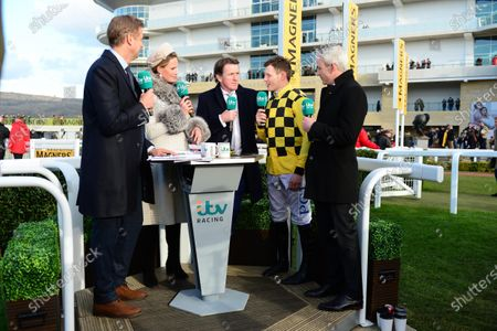 Stock Image of Cheltenham. Magners Cheltenham Gold Cup Chase (Grade 1) of £625,000.00. AL BOUM PHOTO jockey Paul Townend interviewed by ITV Raceing (L-R) Ed Chamberlain, Francesca Cumani, Tony McCoy and Ruby Walsh.