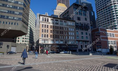 Stock Picture of The pedestrian crossing and food truck location at the corners of Atlantic and Summers Streets in the Financial District are empty, in Boston, Massachusetts, USA, 16 March 2020. In an effort to control the spread of Coronavirus COVID-19, Massachusetts Governor Charlie Baker ordered a three-week suspension of school operations as well as limiting gatherings to 25 individuals and prohibiting on-premises consumption of food or drink at bars and restaurants, beginning on 17 March and effective until 06 April. Baker also asked for employers to have employees telecommute when possible.