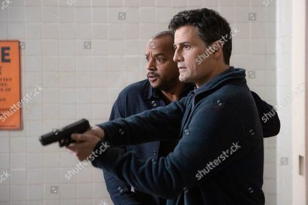 Stock Photo of Donald Faison as Alex Evans and Enver Gjokaj as Agent Ryan Brooks