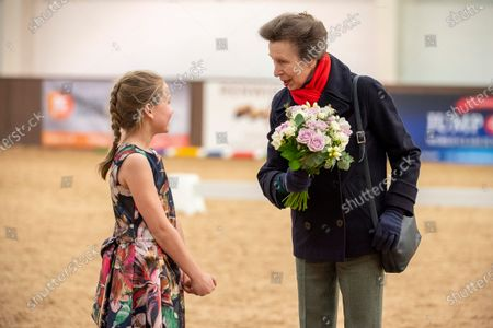 Her Royal Highness Princess Anne is presented with a posy by Miss Zoe Copeland (age 9) at the British Horse Society National Coaching Convention at Addington Equestrian Centre, Buckinghamshire, United Kingdom - 16 March 2020