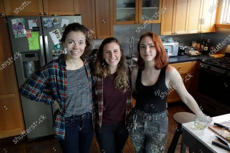 Rebecca Sirull, center, poses for a photo with her roommates, Anna Thomas, left, and Madeleine Busch, at the home they share in Seattle. Earlier in the day, Sirull was the third person to receive a shot of a potential vaccine for the COVID-19 coronavirus at the start of the first-stage safety study clinical trial of the vaccine at the Kaiser Permanente Washington Health Research Institute in Seattle