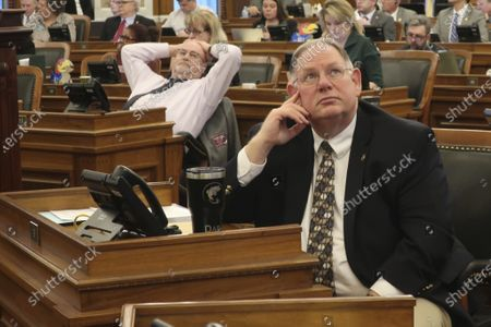 Kansas House Majority Leader Dan Hawkins, R-Wichita, watches an electronic vote-tallying board as the chamber approves a plan for improving the state's highway system, at the Statehouse in Topeka, Kan. Top Republicans in the GOP-controlled Legislature want to approve a transportation bill before lawmakers take an early and long spring break because of the coronavirus pandemic