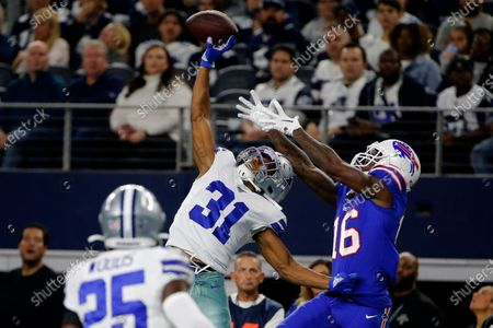 Dallas Cowboys cornerback Byron Jones (31) breaks up a pass intended for Buffalo Bills wide receiver Robert Foster (16) in the first half of an NFL football game in Arlington, Texas. After months of hoarding resources for rebuilding, the Miami Dolphins finally started spending, when they sealed deals with four likely starters in the early hours of free agent negotiations. Miami made Jones the NFL's highest-paid cornerback, surpassing his new teammate, Xavien Howard