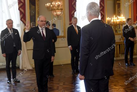 Belgian Minister of Justice Koen Geens takes an oath before King Philippe of Belgium at the Royal Palace in Brussels, Belgium, 17 March 2020. An agreement has been reached between ten parties to give majority support to the current federal government of actual Prime Minister Sophie Wilmes, which will be able to use special powers for a maximum of 6 months.