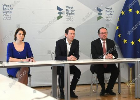 Austrian Chancellor Sebastian Kurz (C), Austrian Foreign Minister Alexander Schallenberg (R) and Austrian Minister for European Union Affairs Karoline Edtstadler (L) attend a Western Balkan video conference at the Austrian Chancellery in Vienna, Austria, 17 March 2020. Kurz, the Heads of Governments of Western Balkan countries and European Commissioner in charge of neighbourhood and enlargement policy, discuss further steps to bring the states closer to the European Union and current political issues. Due to the SARS-CoV-2 coronavirus outbreak, a Western Balkan meeting in Vienna was cancelled and is held as a video conference instead. Participants: Prime Minister of Albania Edi Rama, head of the Council of Ministers of Bosnia and Herzegovina Zoran Tegeltija, Prime Minister of the Republic of Kosovo Albin Kurti,  Montenegro President Dusko Markovic, North Macedonia's temporary Prime Minister Oliver Spasovski, Serbian Prime Minister Ana Brnabic and European Commissioner in charge of neighbourhood and enlargement policy, Oliver Varhelyi.