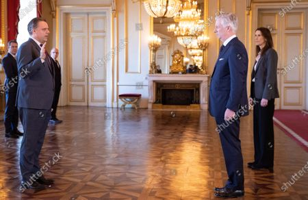 Minister of Social Fraud, Privacy, the North Sea, Telecommunication and Administrative Simplification Philippe De Backer, King Philippe and Belgian Prime Minister Sophie Wilmes pictured during the oath ceremony at the Royal Palace