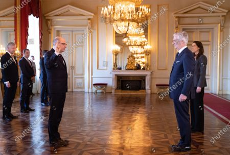 Minister of Justice Koen Geens, King Philippe and Belgian Prime Minister Sophie Wilmes pictured during the oath ceremony at the Royal Palace
