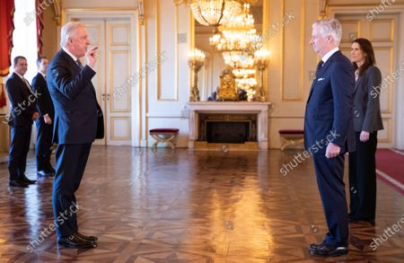 Minister of Pensions Daniel Bacquelaine, King Philippe and Belgian Prime Minister Sophie Wilmes pictured during the oath ceremony at the Royal Palace