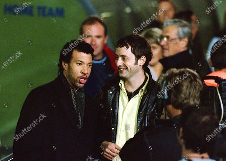 American singer songwriter, composer, Lionel Richie is interviewed by TV presenter, Matt Allwright of BBC Watchdog ahead of kick-off as he walked around the ground meeting fans during Wycombe Wanderers vs Notts County, Nationwide League Division Two Football at Adams Park on 6th October 2000