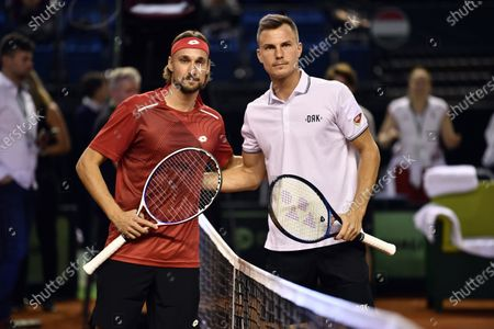 Belgian Ruben Bemelmans and Hungarian Marton Fucsovics pose before a tennis match, the fifth rubber of the first round qualifiers in the Davis Cup World Group between Belgium and Hungary