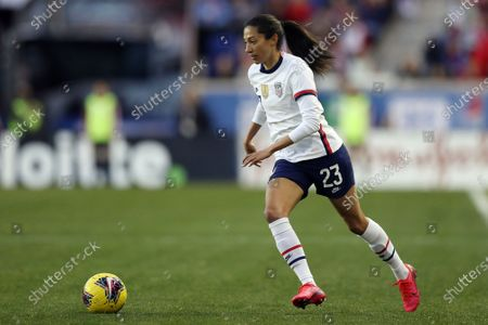 United States forward Christen Press (23) moves the ball up the pitch during the second half of a SheBelieves Cup soccer match against Spain, in Harrison, N.J. The United States won 1-0
