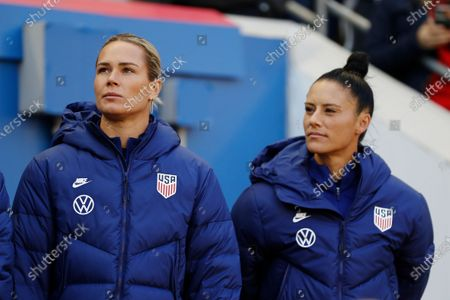 United States goalkeeper Ashlyn Harris, left, and United States defender Ali Krieger look out from the bench before the first half of a SheBelieves Cup soccer match against Spain, in Harrison, N.J. The United States won 1-0